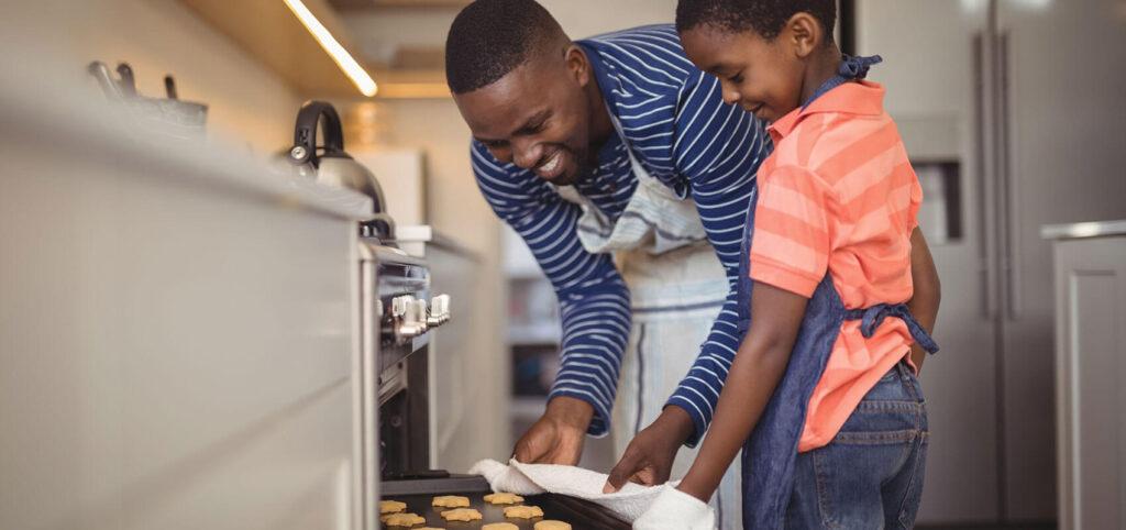 Black man and child baking
